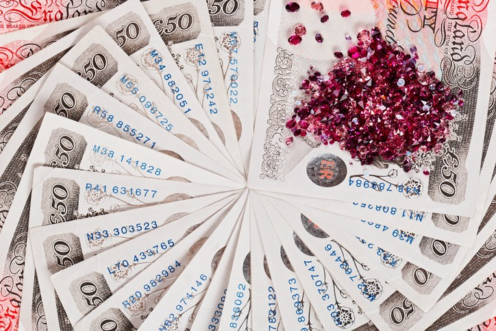 50 pound sterling bank notes with diamonds closeup view business background