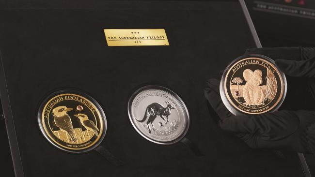 Three giant gold Australian coins.