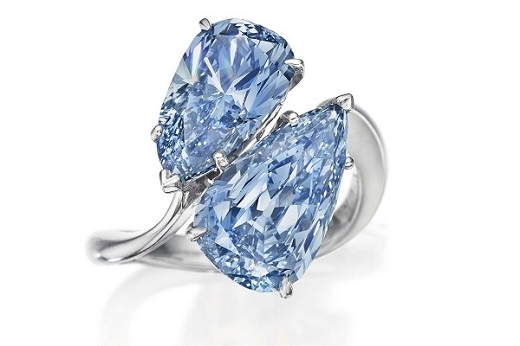 A 2 pear-shaped blue diamond ring.