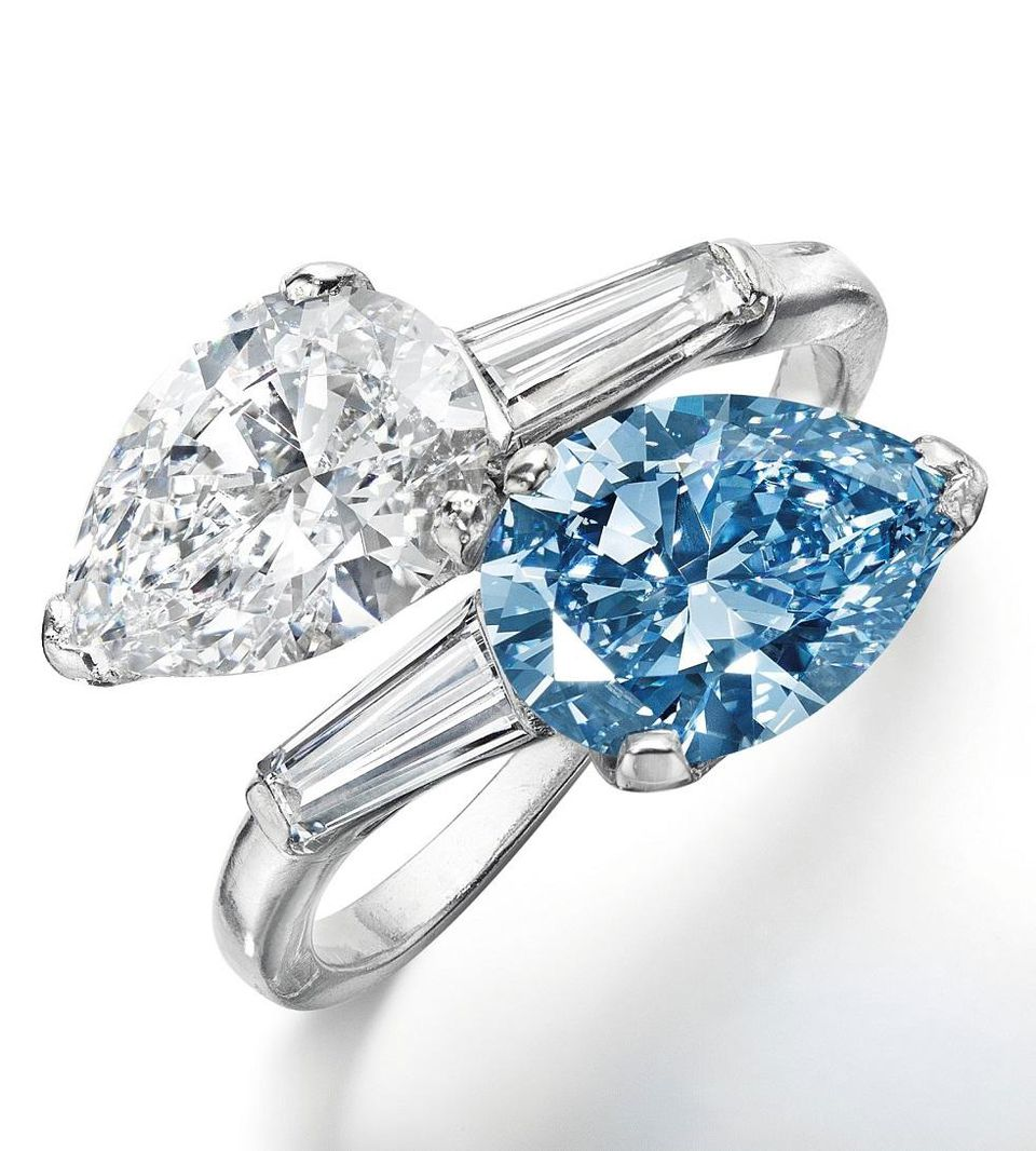 A pear brilliant-cut fancy vivid blue and colorless diamond ring.