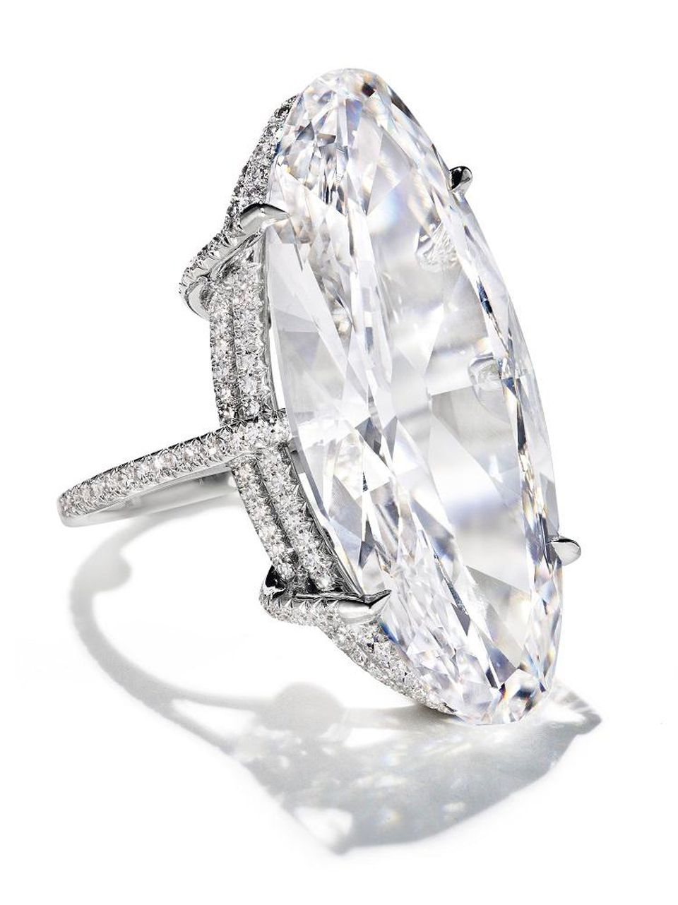 A diamond thread elongated oval brilliant-cut diamond ring.