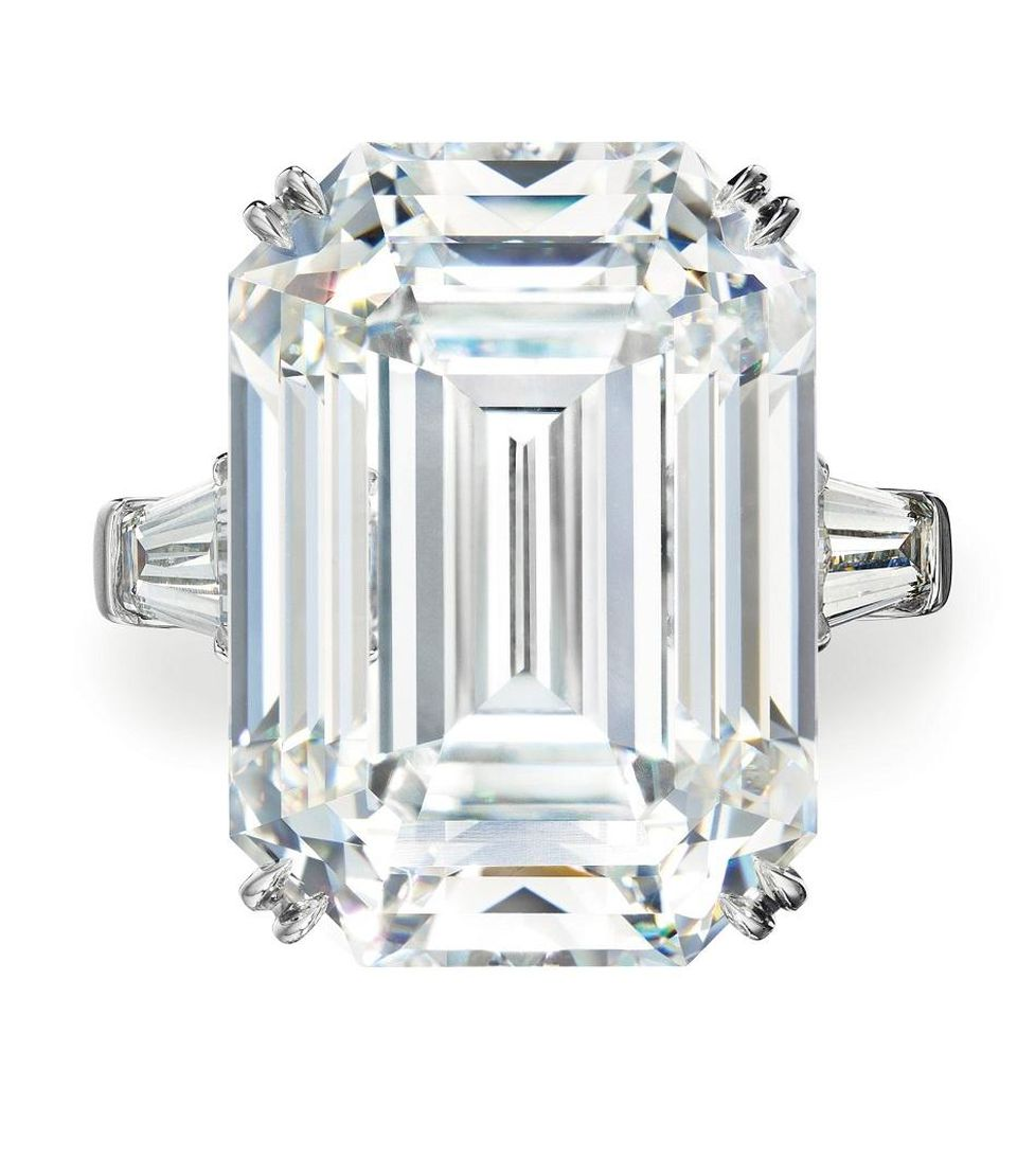 A rectangular-cut colorless diamond ring.