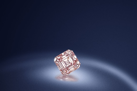 A square-cut fancy-pink diamond.