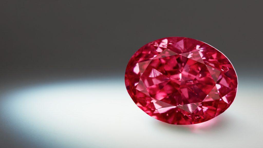 A fancy purplish red diamond.
